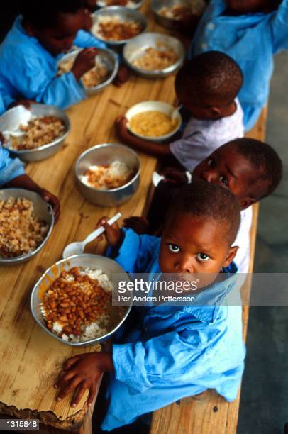 Orphans with AIDS-related diseases eat a meal July 6, 2001 at Murchison hospital outside Port Shepstone in Southern Natal, South Africa. It''s...