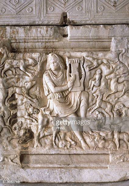 Orpheus wearing a Phrygian cap and surrounded by the beasts charmed by the music of his lyre Relief from Thessaloniki Greece