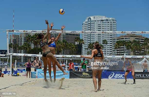 Orquidea Vera of Venezuela spikes the ball against Taylor Pischke and Melissa Humana-Paredes of Canada as Olaya Perez Pazo looks on during the FIVB...