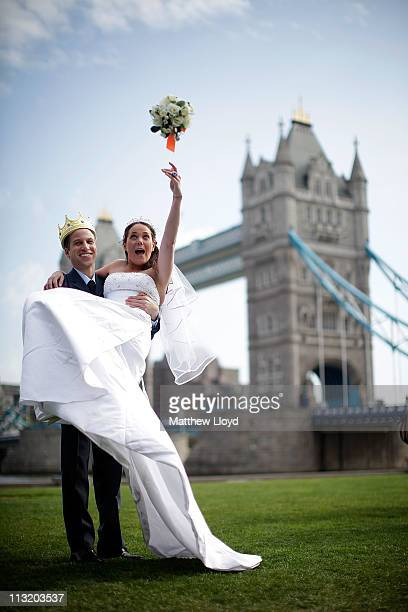 Orsola Rossi from Italy and Simon Watkinson from England pose for pictures after winning a Prince William and Catherine Middleton lookalike...