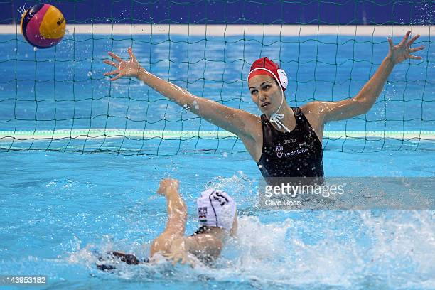 Orsolya Kaso of Hungary dives to make a save during the Visa Water Polo International test event match between Hungary and Great Britain ahead of the...