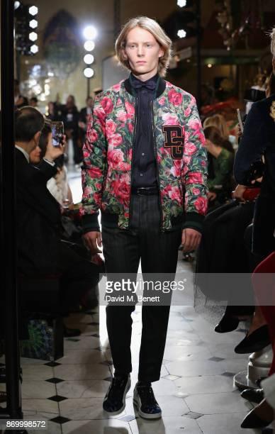 Orson Richards walks the Dolce Gabbana Italian Christmas catwalk show at Harrods on November 2 2017 in London England