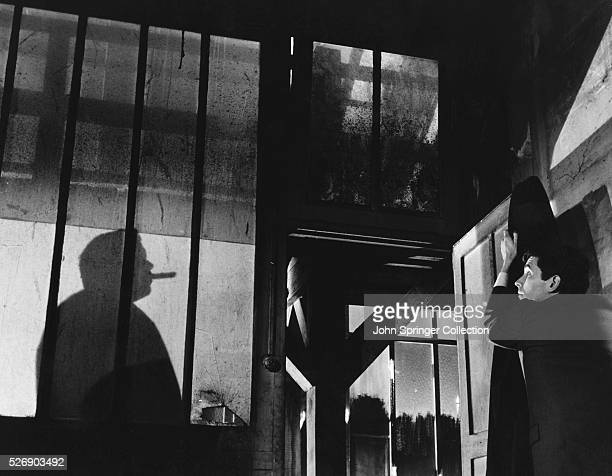 Orson Welles as Hastler and Anthony Perkins as Josef K. In the 1962 film Le Proces, the film version of Franz Kafka's story.