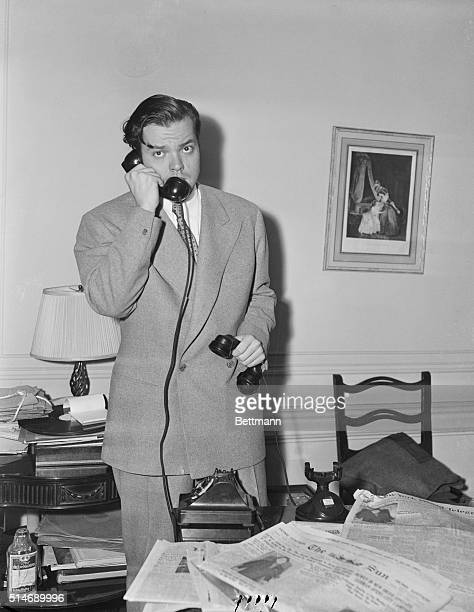 Orson Welles is busy taking telephone calls and reading the newspapers on the day after his infamous War of the Worlds broadcast.
