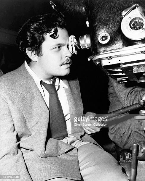 Orson Welles , US actor and film director, looking into the eyepiece of a movie camera during the filming of 'The Stranger', 1946. The film noir,...