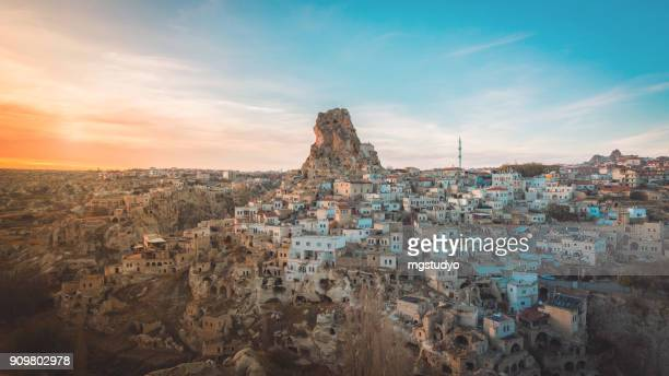 Ortahisar cave city in Cappadocia, Turkey on sunset