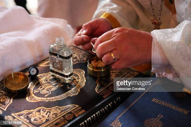 orthodox baptism in the church, accessories ready for epiphany, transylvania, romania - orthodox church stock pictures, royalty-free photos & images