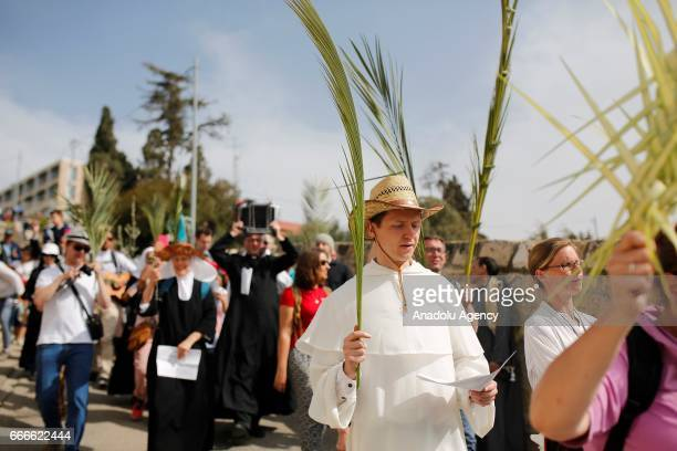 Orthodox Christian worshippers gather in front of Bab esSahire of the Jerusalem's Old City during 'Palm Sunday' celebrations in Jerusalem on April 09...