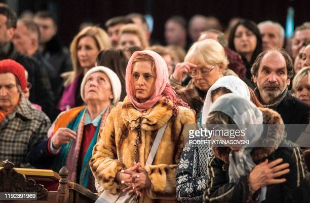 Orthodox Christians attend a religious service to celebrate the Orthodox Christmas in St Clement Cathedral in Skopje on January 7 2020 Orthodox...