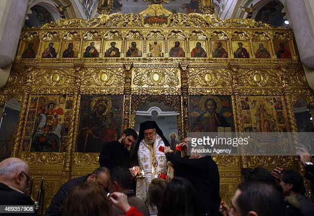 Orthodox Christians attend 'Holy Fire' mass on Holy Saturday ahead of the Easter at Greek Orthodox Saint George Church in Beirut Lebanon April 11...