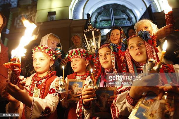 Orthodox Christians attend 'Holy Fire' mass on Holy Saturday ahead of the Easter at Vladimir Cathedral Church in Kiev on April 11, 2015. Holy Fire is...
