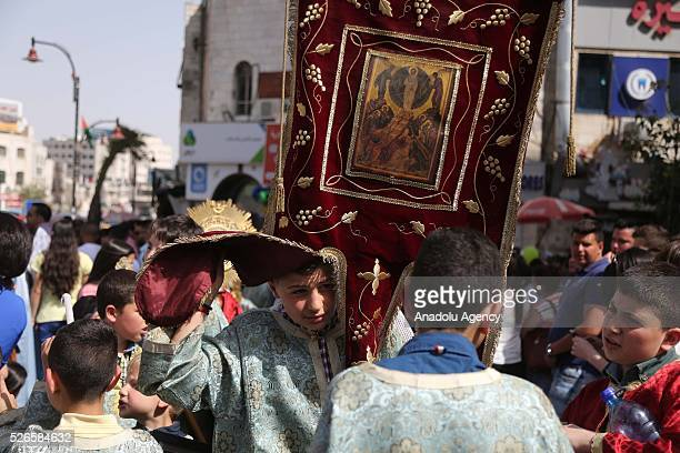 """Orthodox Christians attend the """"Holy Fire"""" parade on Holy Saturday ahead the Easter at the streets of Ramallah in West Bank on April 30, 2016. Holy..."""