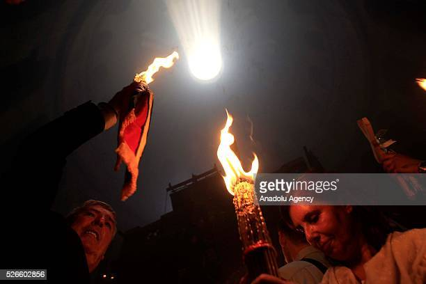 Orthodox Christians attend the Holy Fire parade on Holy Saturday ahead the Easter at the Church of the Holy Sepulchre in West Bank on April 30 2016...