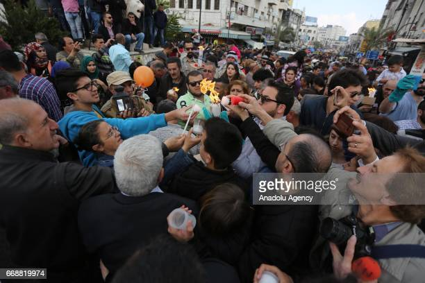 Orthodox Christians attend the 'Holy Fire' parade on Holy Saturday ahead the Easter at the Church of the Holy Sepulchre in Ramallah, West Bank on...