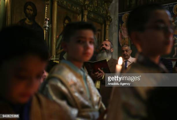 Orthodox Christians attend the Palm Sunday procession in Gaza City Gaza on April 01 2018 Palm Sunday is celebrated on last Sunday before the 'Easter'...
