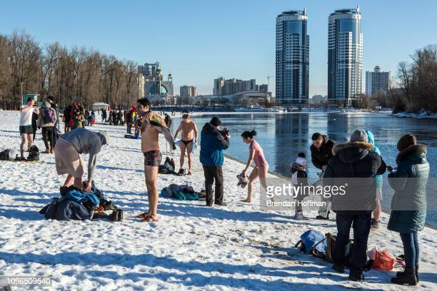 Orthodox Christians bathe in the Dnieper River for Epiphany on January 19 2019 in Kiev Ukraine The holiday celebrates the baptism of Jesus for...