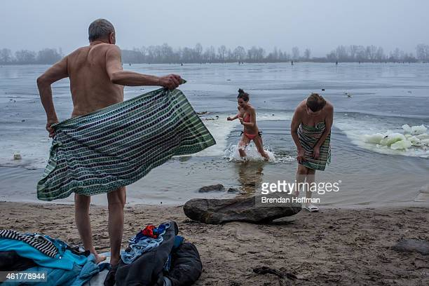 Orthodox Christians bathe in the Dnieper River for Epiphany on January 19 2015 in Kiev Ukraine The holiday celebrates the baptism of Jesus for...