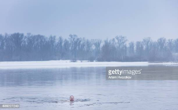 orthodox christians celebrate epiphany with ice swimming . jesus christ's baptism in the river of dniper - laughing jesus images stock pictures, royalty-free photos & images