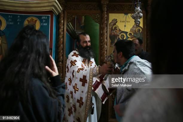 Orthodox Christians celebrate the Epiphany inside the Church of St John the Baptist on February 2 2018 in Tal elKharrar Jordan Every year Christians...