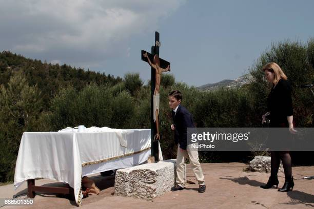 Orthodox Christians flock to worship the Crucified during the Apokathilosis a reenactment of the Deposition of Christ from the Cross at Pendeli...
