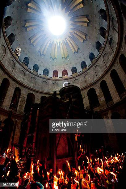 Orthodox Christians light candles during the Holy Fire ceremony in the Church of the Holy Sepulchre on April 3 2010 in Jerusalem Israel The Church is...