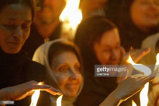 Orthodox Christians light their candles in the Holy Fire ceremony at what is popularly considered to be the traditional tomb of Jesus in the Church...