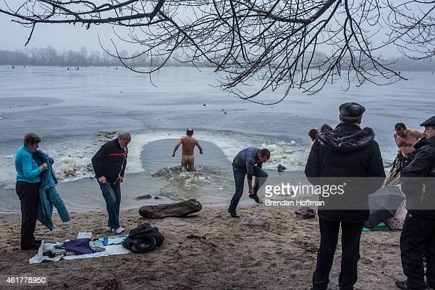 Orthodox Christians prepare to bathe in the Dnieper River for Epiphany on January 19 2015 in Kiev Ukraine The holiday celebrates the baptism of Jesus...