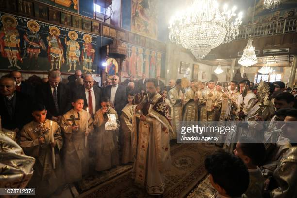 Orthodox Christians take part in an Orthodox Christmas mass held at the Saint Porphyrius Orthodox Church in Gaza City Gaza on January 7 2019