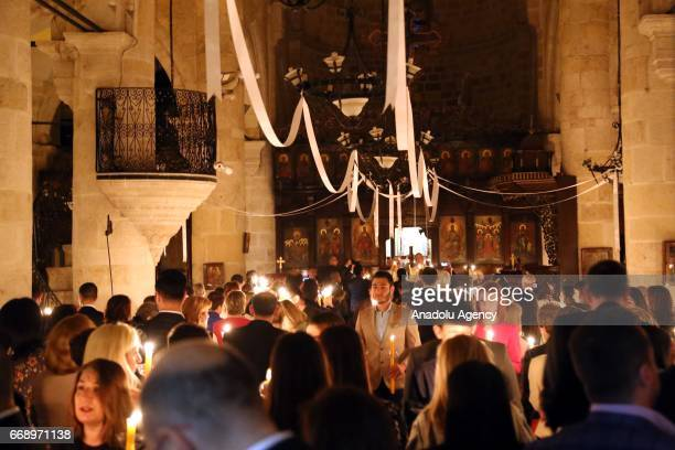 Orthodox Christians take part in the Easter Vigil within Easter celebrations at a church in Hatay Turkey on April 15 2017