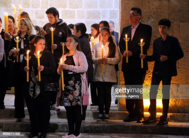 Orthodox Christians take part in the Easter Vigil within Easter celebrations at a church in Hatay, Turkey on April 15, 2017.