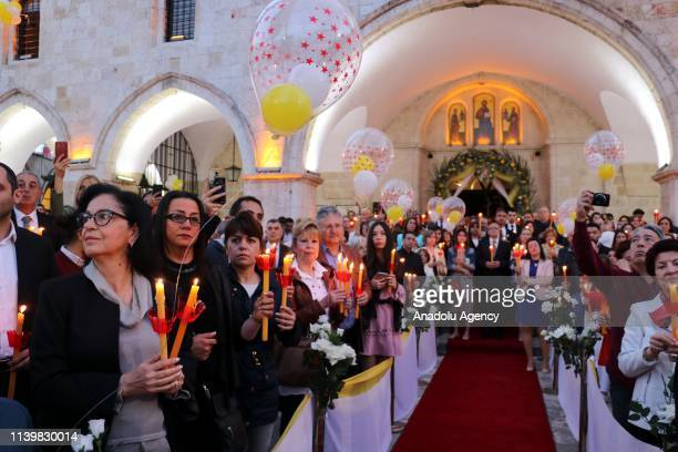 Orthodox Christians take part in the Easter Vigil within Easter celebrations at Antakya Orthodox Church in Hatay Turkey early Sunday on April 28 2019