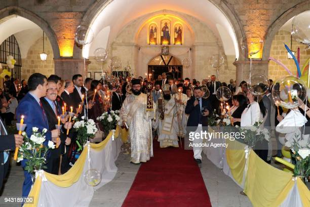 Orthodox Christians take part in the Easter Vigil within Easter celebrations at Antakya Orthodox Church in Hatay Turkey early Sunday on April 8 2018
