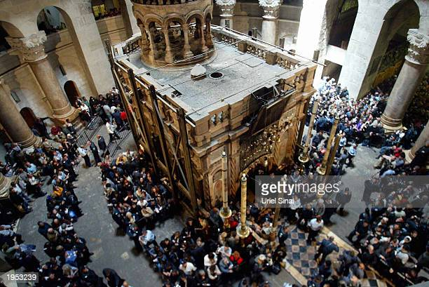 Orthodox Christians take part in the Holy Fire ceremony at what is popularly considered to be the traditional tomb of Jesus in the Church of the Holy...