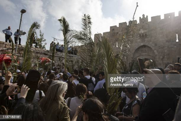 Orthodox Christians take part in the parade in front of Al Esbat Gate of the Jerusalem's Old City during 'Palm Sunday' celebrations in Jerusalem on...