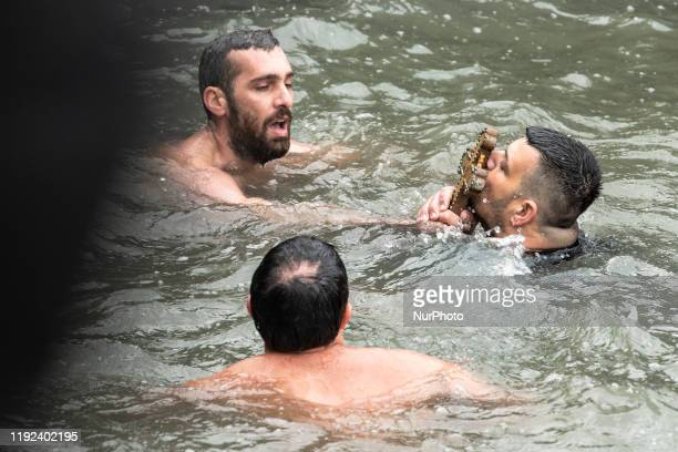 Orthodox faithfuls are seen after diving into icy waters of Bosphorus to retrieve wooden crucifix during theOrthodox Epiphany Day marking the...