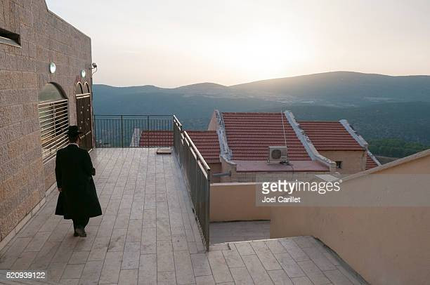 orthodox jew and sunset in safed, israel - safed stock photos and pictures