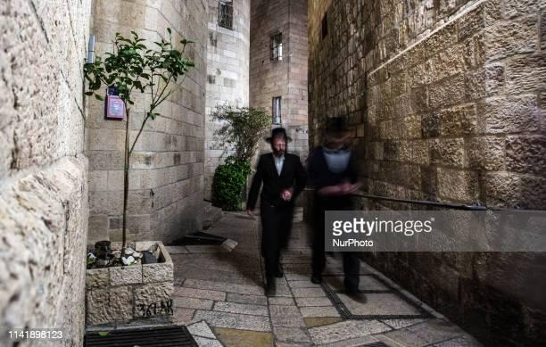 Orthodox Jew walks the street of the Jewish Quarter of Old City of Jerusalem, Israel on April 6, 2019.