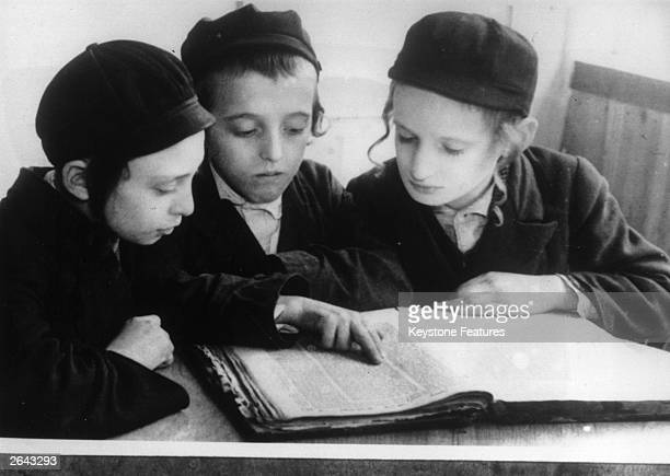 Orthodox Jewish boys study the Hebrew Talmud in the Jewish area of Warsaw, 1938.