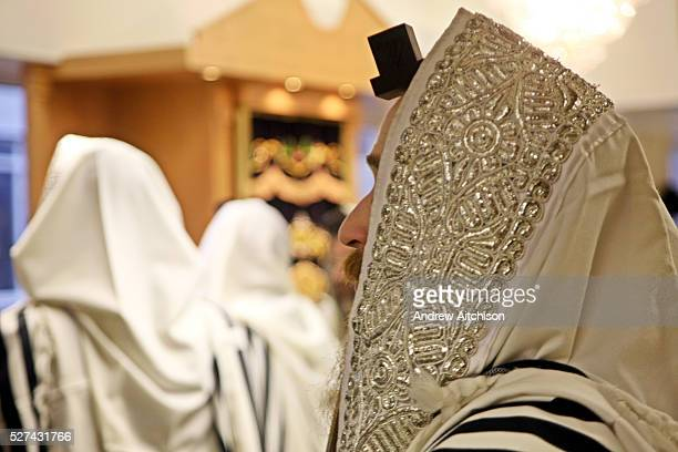 Orthodox Jewish men belonging the Bobov Hasidism during morning prayer inside a Stamford Hill synagogue. Communal praying in a minyan is preferred by...