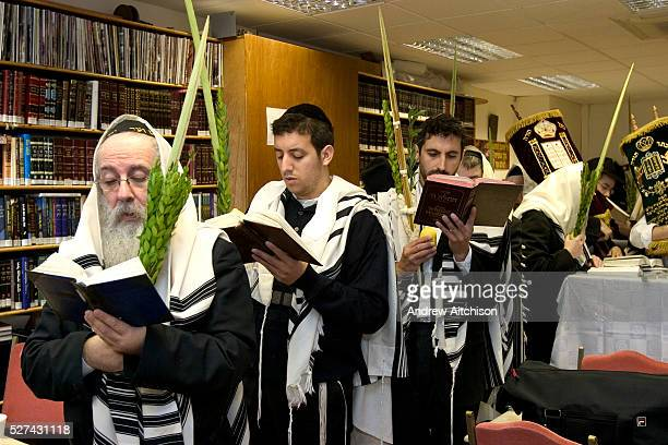 Orthodox Jewish men from Old Hill Street Synagogue parade 7 times around the Bimah in the synagogue shaking the Lulav for the festival of Sukkot the...