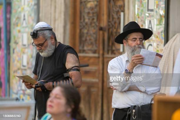 orthodox jewish men in tel aviv, israel - jewish prayer shawl stock pictures, royalty-free photos & images