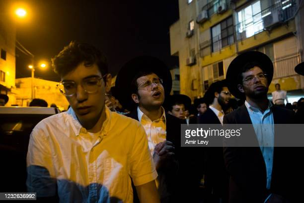 Orthodox Jewish men mourn at the funeral of Chaiem Ozer Seler died at a Lag BaOmer ceremony on May 1, 2021 in Bnei Brak, Israel. 45 people died and...