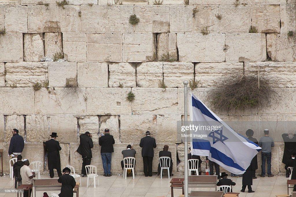 Orthodox Jewish men praying at Western Wall : Stock Photo