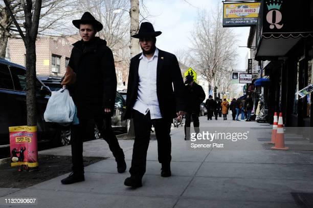 Orthodox Jewish men walk through the neighborhood of Crown Heights on February 25 2019 in New York City The historic Brooklyn neighborhood has...
