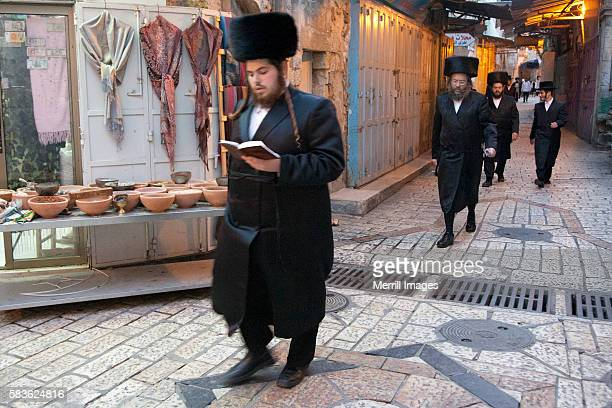 Orthodox Jewish men walking to Synagogue iin Old City of Jerusalem, Israel