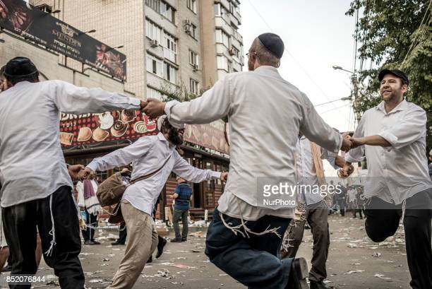 Orthodox Jewish pilgrims dance while celebrating Rosh Hashanah in Uman about 200 km South of Kyiv Ukraine on 22 September 2017 Every year thousands...