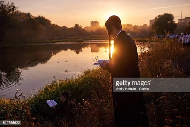 Orthodox Jewish pilgrims pray near lake during the celebrating Rosh Hashanah in Uman Ukraine 03 October 2016 From evening of October 2 to October 4...