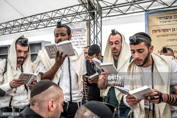 Orthodox Jewish pilgrims pray near the tomb of Rabbi Nachman while celebrating Rosh Hashanah in Uman about 200 km South of Kyiv Ukraine on 22...