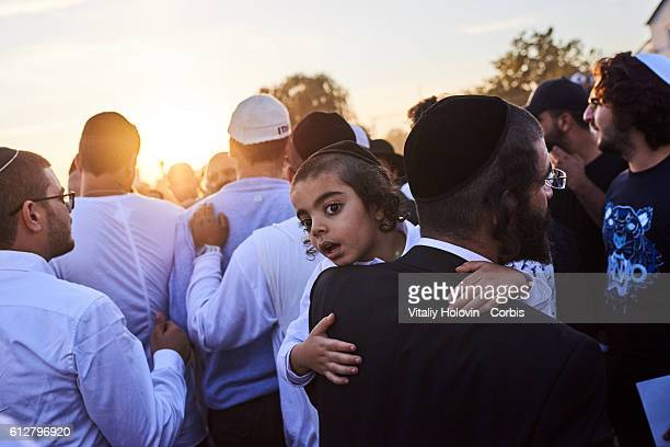 Orthodox Jewish pilgrims rest near lake after pray during the celebrating Rosh Hashanah in Uman Ukraine 03 October 2016 From evening of October 2 to...