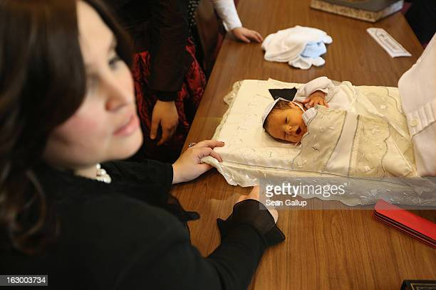Orthodox Jewish women surround baby infant Mendl Teichtal following the baby's circumcision cermony at the Chabad Lubawitsch Orthodox Jewish...